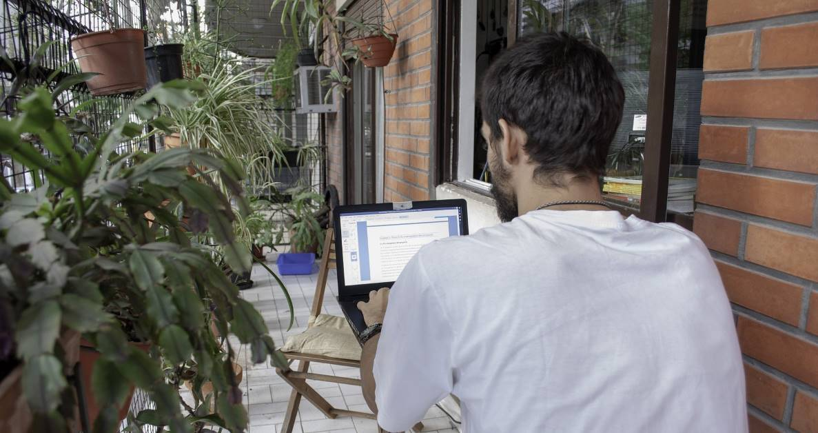 Picture of man using laptop at home